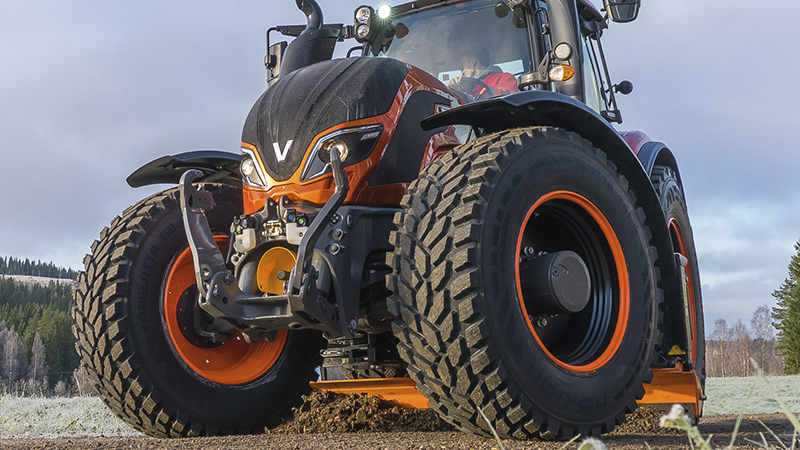 valtra unlimited custom tractor with candy orange paint